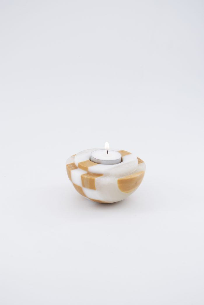 Round with a narrow base, a candle holder in brown and white.