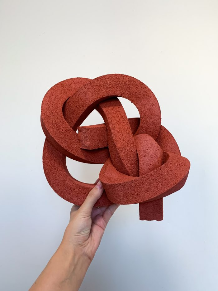 Thick brick-red foam-covered knot.