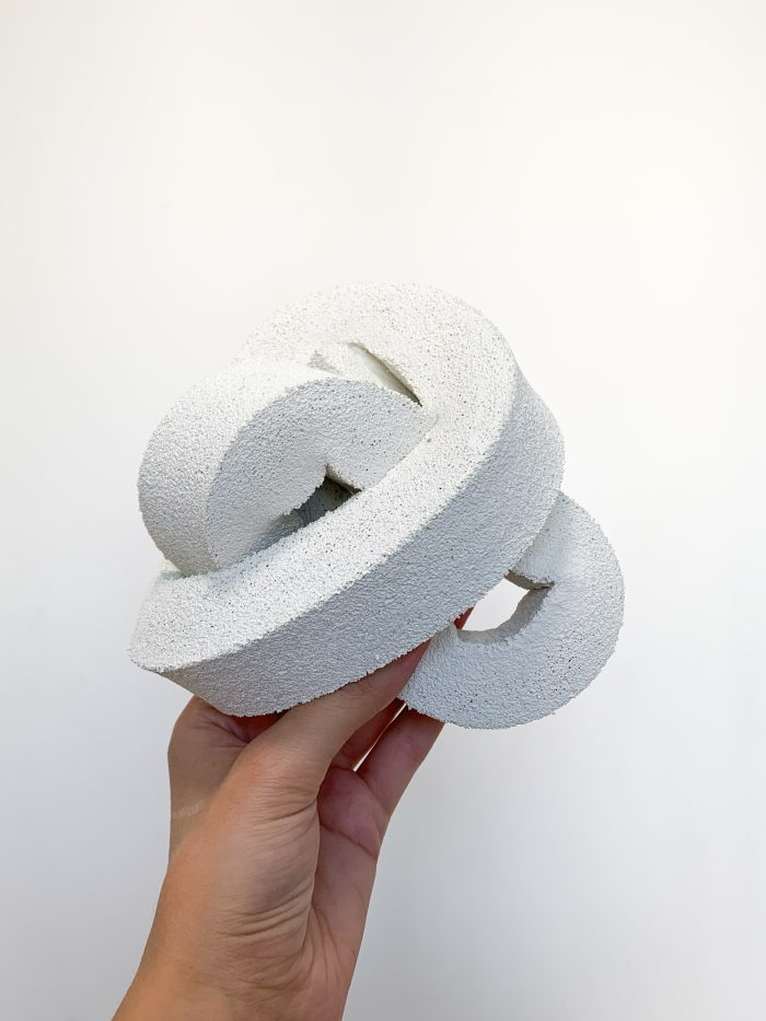 Thick, white-coloured foam-covered knot.