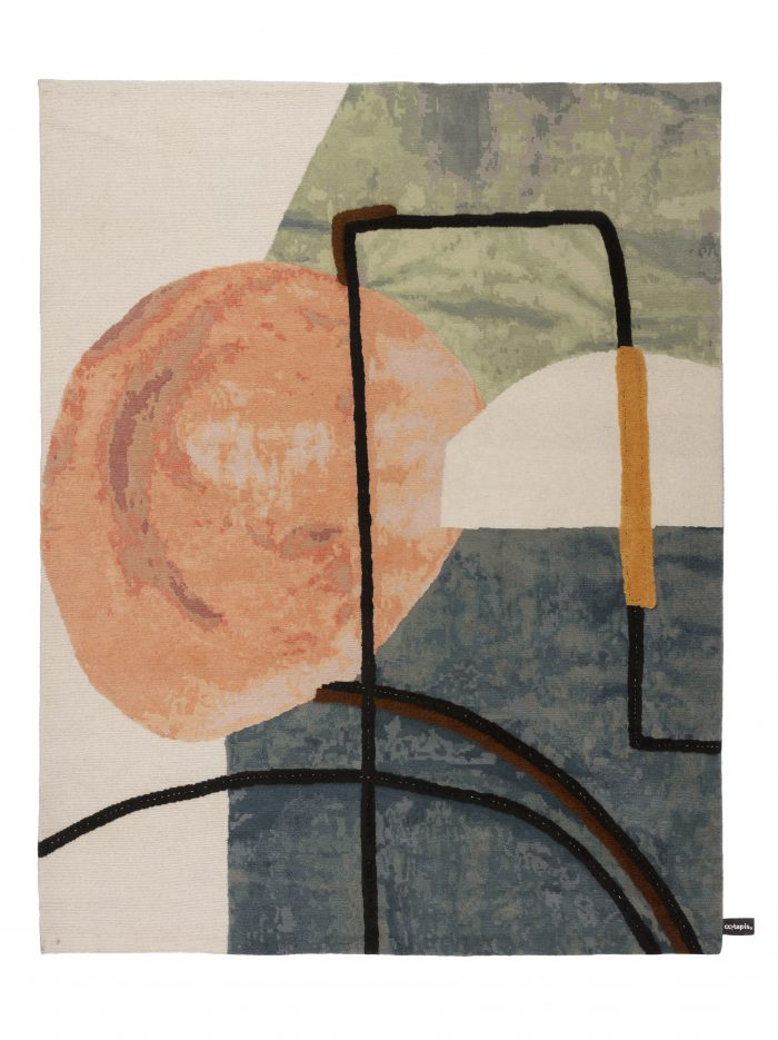 Rug with orange, pink, black and blue patches in an abstract scene of an interior with a table.