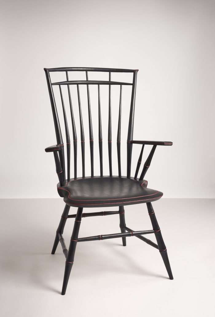 Square-backed, ribbed wooden armchair. The struts create the image of a elegant birdcage.