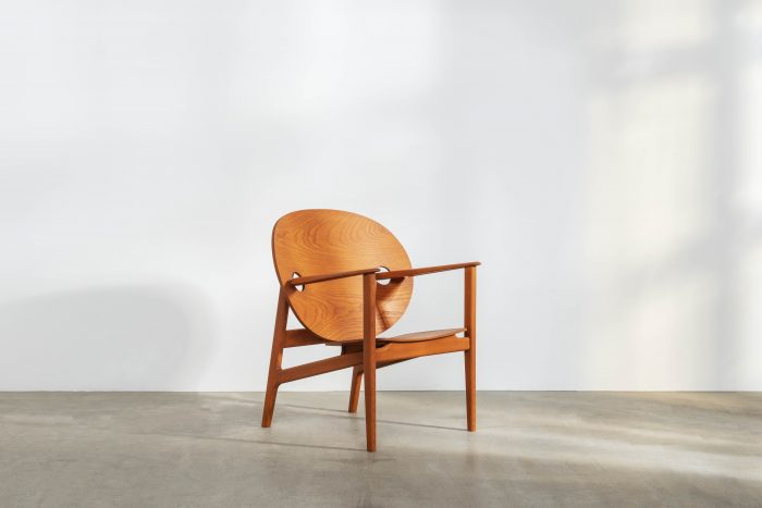 Iklwa lounge chair, a light brown chair with a curving round back.