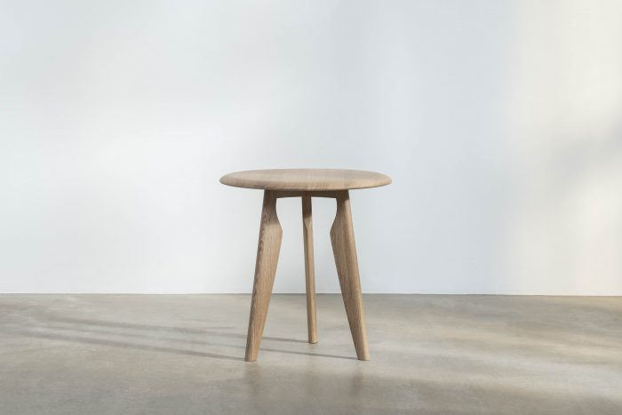Delicate and stylish light brown side table.