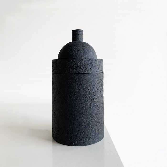 Tall, textured black container, with a rounded lid.